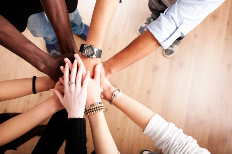 Hands joining together forming a partnership
